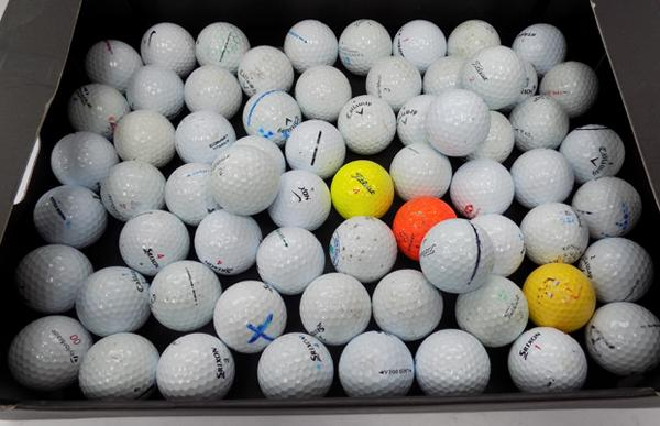 Box of top brand golf balls
