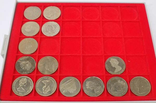14 coins in Lindner coin collector's case