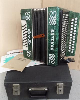 Russian 50 button accordion, in case, with original paperwork + keys