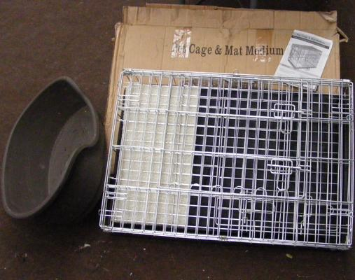 Small dog/cat cage (in box) with small plastic bed