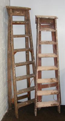 Two sets of pine step ladders