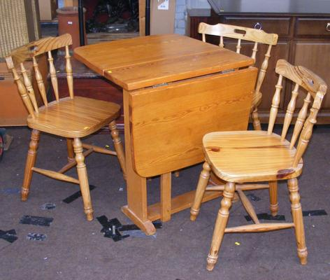 Folding pine table and three pine chairs