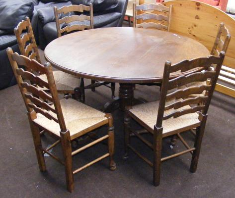 Oak table and 6 oak ladder back chairs