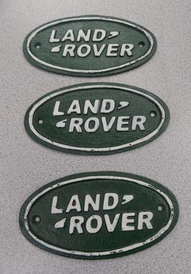 3 cast iron Land Rover plaques