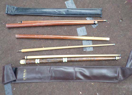 Selection of three snooker/pool cues