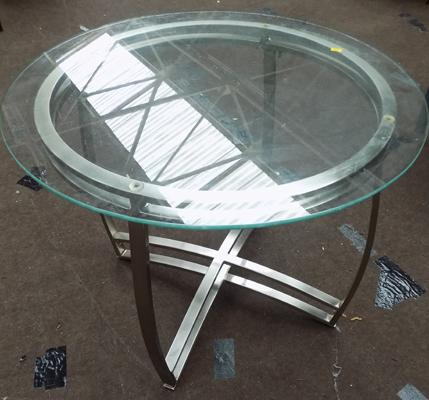 Circular glass topped coffee table