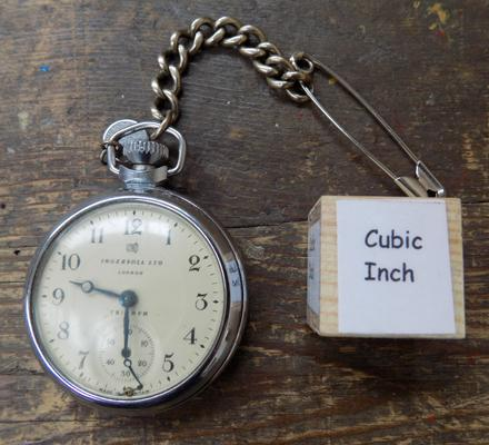 Ingersol triumph London pocket watch with silver fob and chain