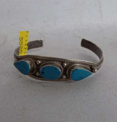 Silver & turquoise bangle with age related ware