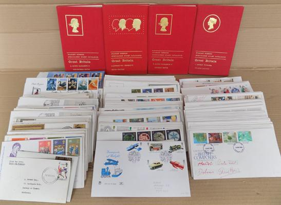Assortment of over 200 British first day covers and Stanley Gibbons valuation books