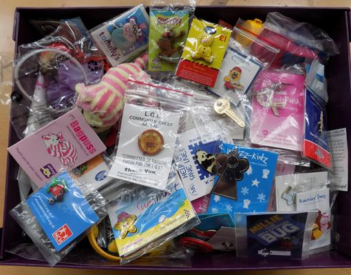 Large selection of charity badges, wrist bands, red noses, soft toys etc.