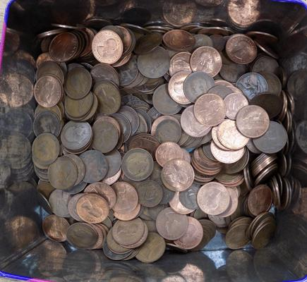 Large tin of penny coins