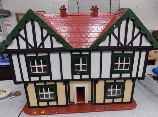 Large dolls house containing some furniture & figures