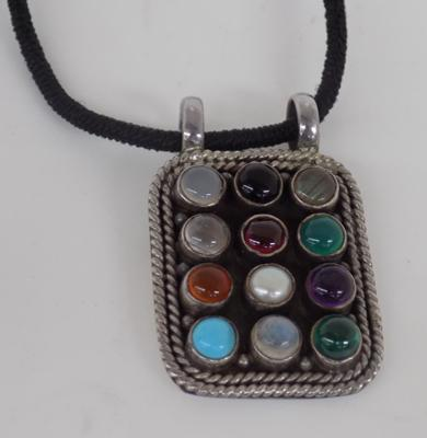 Sterling silver pendant with mixed stones