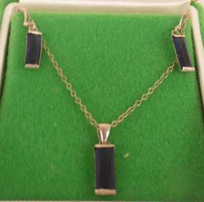 Sterling silver pendant and earring set with blue stone