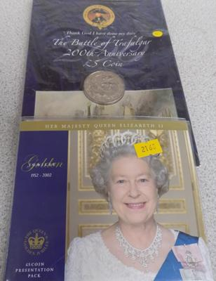 2x £5 commemorative coins in folders