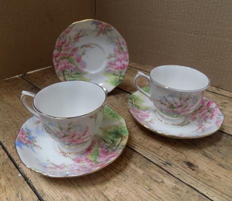 Pair of Royal Albert 'blossom time' cups and sauces with spare saucer