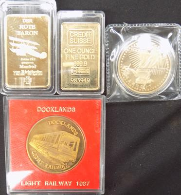 2 collector's coins and 2 collector's bullion bars