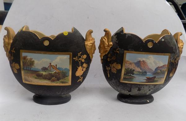 Pair of black & gilt vases with painted scene, one damaged