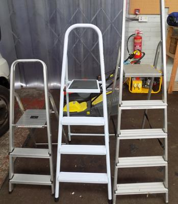 Four sets of metal ladders