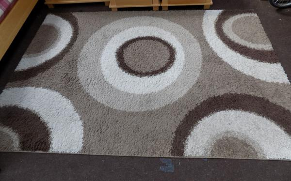 Large beige & brown rug with circle design