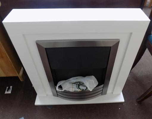 Electric fire with white surround w/o (wires into wall)
