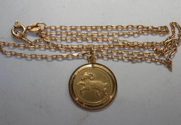 "9ct gold chain - 17"" long and 9ct gold Aries pendant"