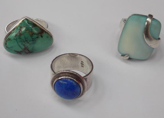 3 silver rings with large stones