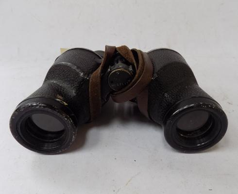 Pair of 6 x 30 binoculars with Westinghouse 1942 HMR on shoulder