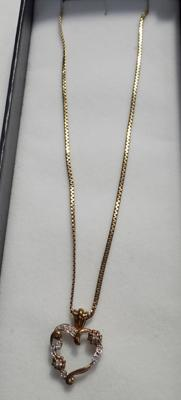 "9ct gold 24 1/2"" chain with a 9ct gold diamond heart pendant"