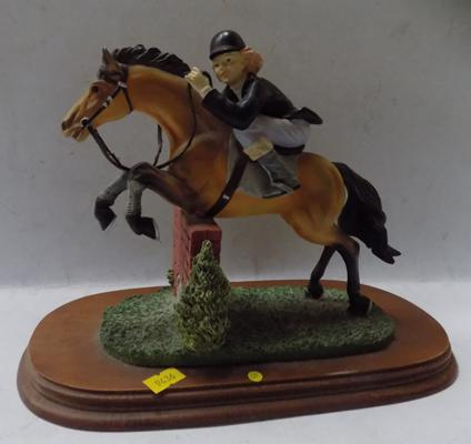 Horse and rider over a wall figurine