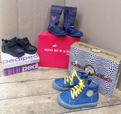 Three boxed pairs of branded shoes