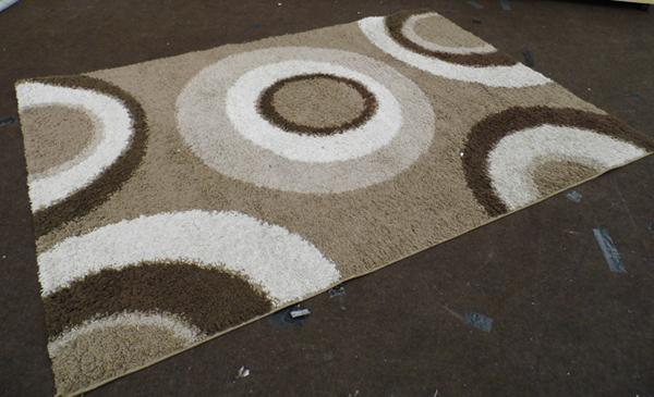 Large beige rug with circles design - brown and beige