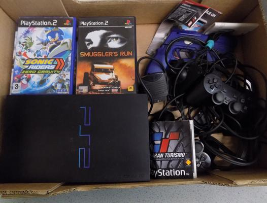 Playstation 2 + controllers, accessories + various PS2 games