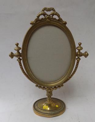 Ornate brass oval picture frame