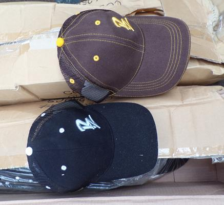 2 boxes of approx. 50 baseball hats