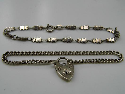 2x Silver bracelets (1 with Teddy Bear links and 1 with heart locket)
