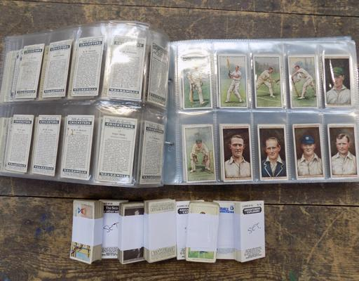 Pages and tub of mixed cigarette cards