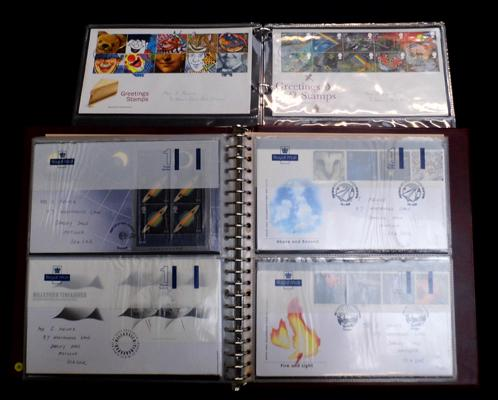 2 well filled albums of FDCs, miniature sheets etc...