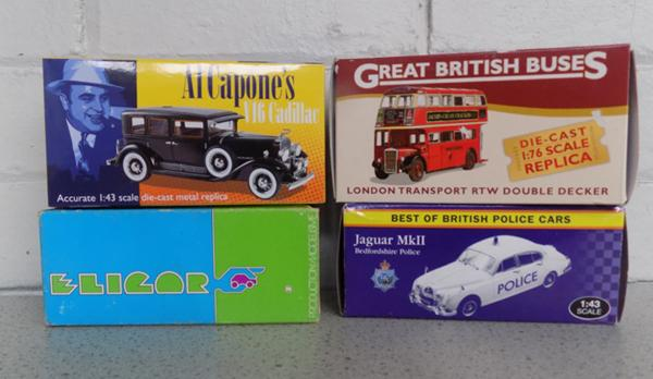 4 boxed collector's diecast 1/42 scale