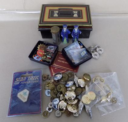 Assortment of badges, bank saving container, porcelain sailors + military badges & buttons