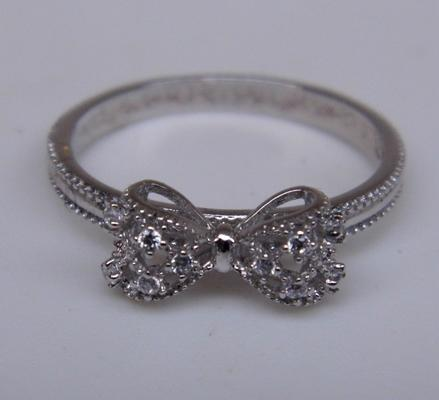 Silver bow ring, new with box