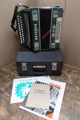 Russian S2 button accordian with lockable case & paperwork-full working order