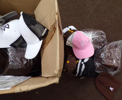 Box of beanie hats and baseball caps by Ballaz