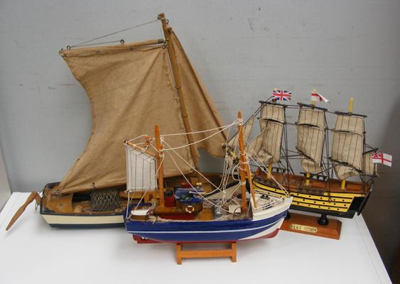 Three small wooden model boats