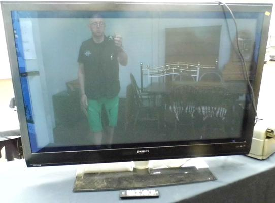 Approx. 50 inch Philips flatscreen TV + remote