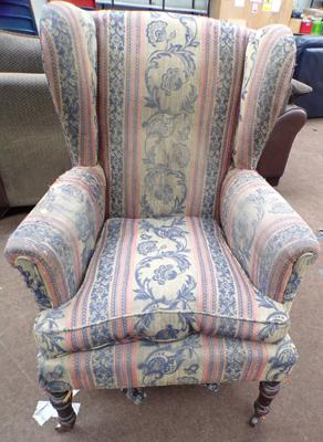 Vintage feather cushioned winged armchair