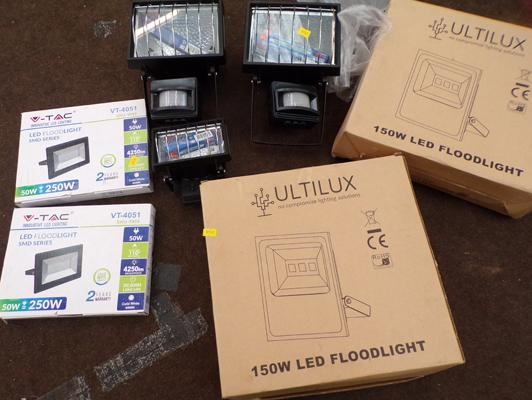 2 x 150 watt LED floodlights, + 2 x 50 W LED floodlights + 3 x halogen floodlights with sensors