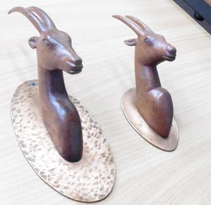 2 carved treen gazelle on copper backs, signed on back by exhibited artist, Wadsworth Smith, approx. 7.5/ 5.5  inches high