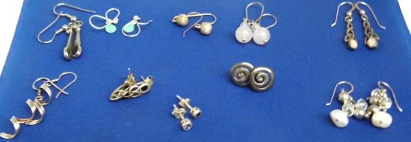 10 pairs  of silver earrings
