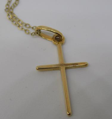 Gold crucifix on chain
